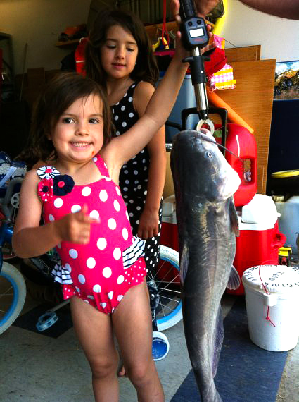 Natalie Batten holding the huge catfish she caught on Boltz Lake over Memorial Day weekend. Her sister Lilly is in the background. (photo submitted)