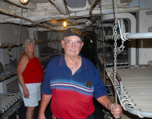 Claude Erwin, a World War II Veteran, standing in the area of the USS LST 325 where the Army bunked while being transported to Normandy, France on D-Day. Also pictured is Linda Erwin. (Photo by Chris Erwin)