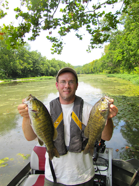 David Baker, stream biologist for the Kentucky Department of Fish and Wildlife Resources, holds two nice smallmouth bass collected from the South Fork of Licking River in Harrison County during population sampling. September and October are fantastic months to fish for smallmouth bass in Kentucky streams. After a wet spring and summer, streams across the state are in the best shape since spring.