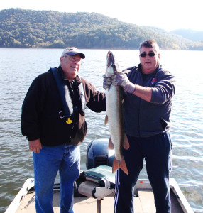 Robbie Jordan and Donnie Ingles are pictured here holding a 44 inch muskie caught on Cave Run Lake just before the lake closed. (photo submitted).