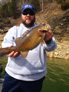 Dustin Rose holding a nice smallmouth caught on Lake Cumberland last week. (photo submitted)