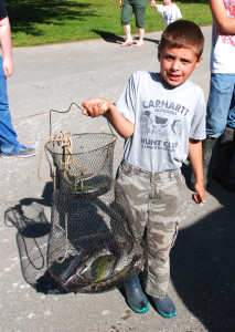 Graysen Cormichael  showing off his mixed bag of catfish,bass and bluegills (photo by Chris Erwin)