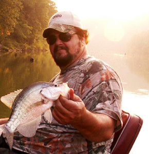 Author Chris Erwin holding a crappie caught on Licking River some 10 miles from the main lake photo by Bill Brainard