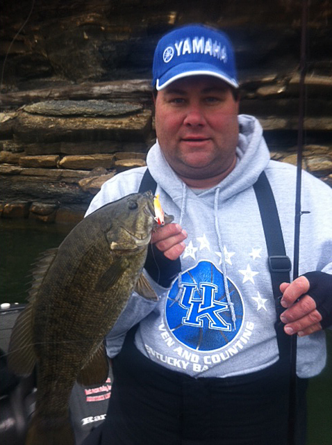 Dustin Rose holding a smallmouth caught on Lake Cumberland. (Photo submitted)