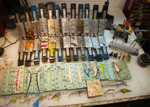 A small portion of author Chris Erwin's lure crafting molds and end products. These will give you a hint at what you can do if you use the off-season to make your own lures for the up-coming fishing season. (Photo by Chris Erwin)