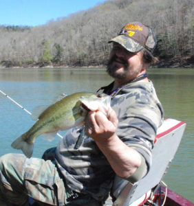 Author Chris Erwin holds one of the bass caught two weeks ago fishing points on Cave Run Lake. (photo by Scott Erwin)