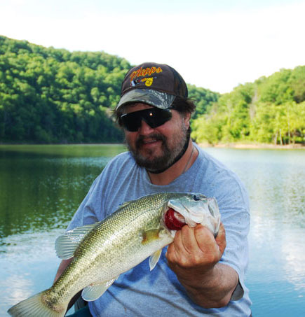 Author Chris Erwin holding one of the bass caught last weekend fishing the post spawn pattern using buzzbaits and crankbaits on Cave Run Lake near Morehead, Ky. (photo by Scott Erwin)