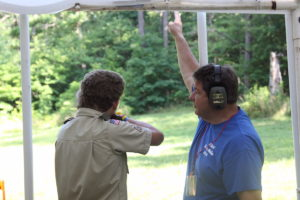 Mark Marraccini, executive staff advisor for the Kentucky Department of Fish and Wildlife Resources, instructs a Boy Scout on the proper fundamentals of mounting a shotgun. Marraccini advises those mentoring young hunters to make sure the youngster knows the proper fundamentals of shooting before placing them in a hunting situation.